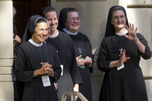 Catholic Sisters watch as Pope Francis departs the Apostolic Nunciature, the Vatican's diplomatic mission in the heart of Washington, heading to the Basilica of the National Shrine of the Immaculate Conception, Wednesday, Sept. 23, 2015. . The Pope will celebrate Mass and canonize Junipero Serra. (AP Photo/Cliff Owen)